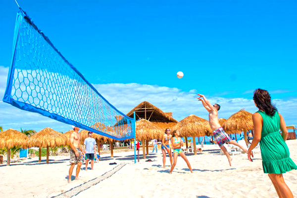 Stay Active Playing Valley Ball at one of our Stops on the best Cozumel bar hop excursion